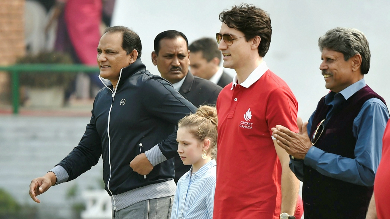 Canadian Prime Minister Justin Trudeau with his daughter Ella-Grace and former Indian cricket team captains Kapil Dev and Mohammad Azharuddin, during their visit to a school in New Delhi. (PTI)
