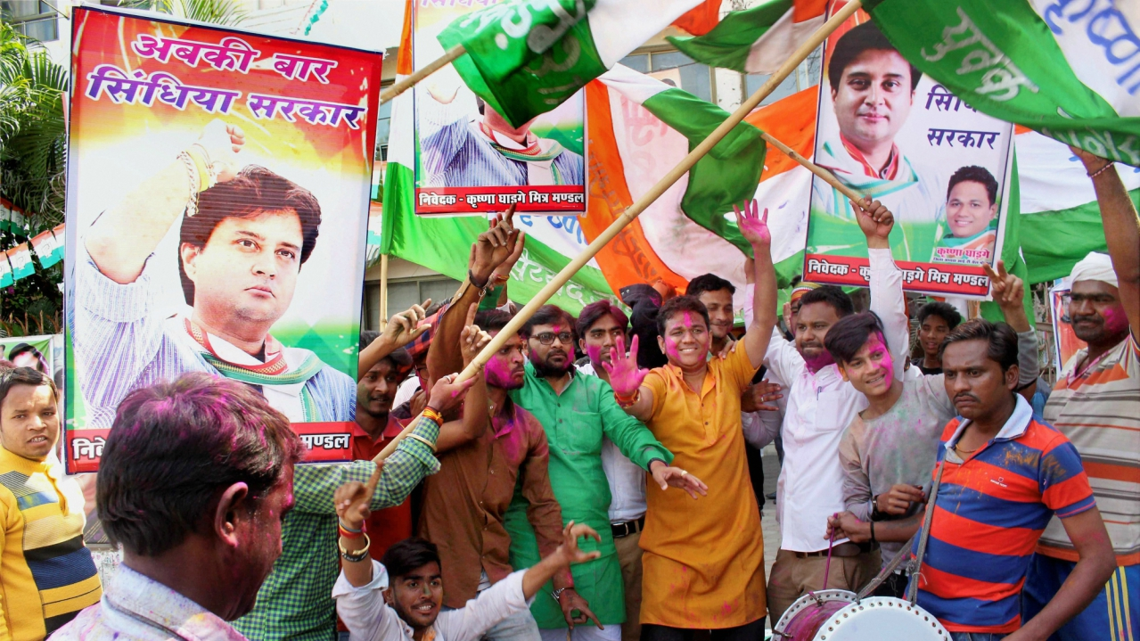Congress party workers celebrate the party's victory in Kolaras and Mungaoli state assembly by-elections at the party's state headquarters in Bhopal. (PTI)