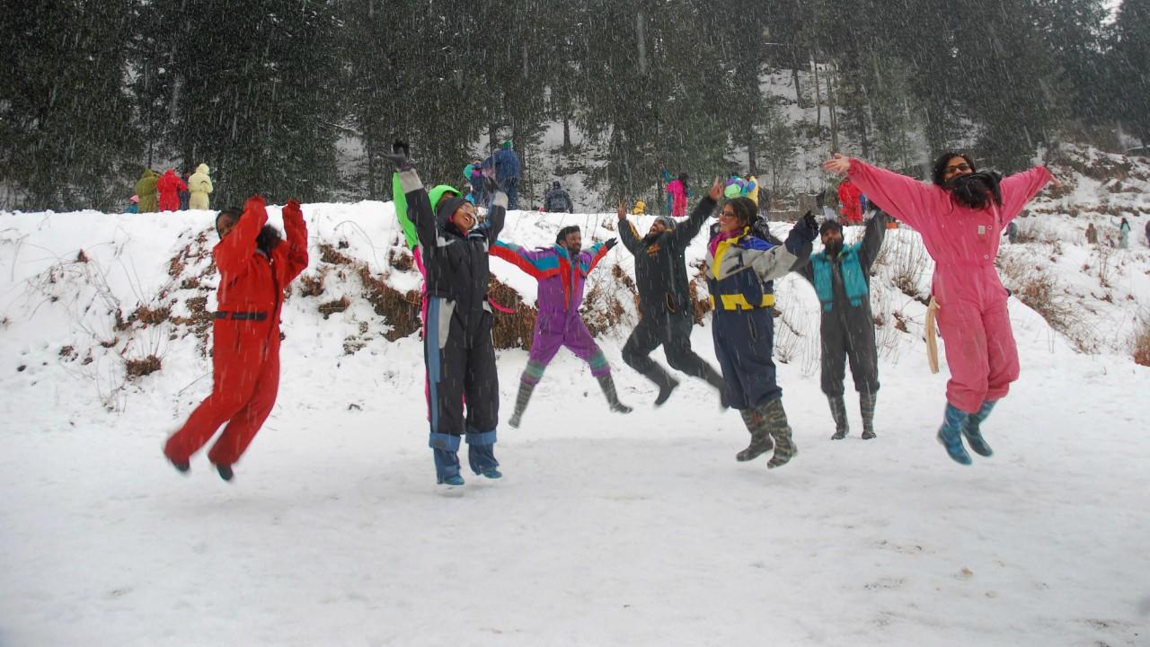 Tourists react in joy as it snows at Kufri near Shimla. (PTI)