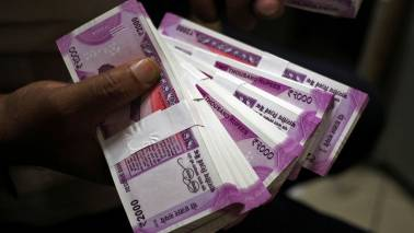 Rupee tumbles on capital flight, hits 3-month low of 65.04