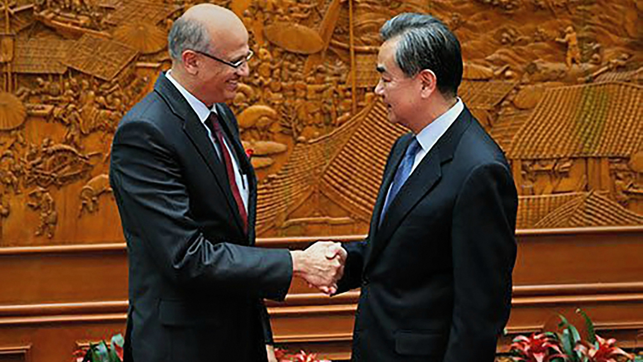 Foreign Secretary Vijay Gokhale shakes hands with Chinese Foreign Minister Wang Yi during a meeting to discuss bilateral agenda, in Beijing. (PTI)