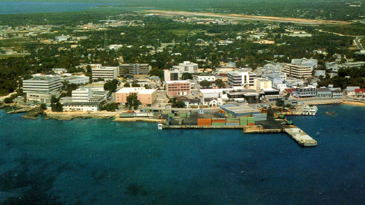 The Cayman Islands | Another British overseas territory which is a tax free autonomous region. According to Deloitte, except stamp duty on transfer of real estate, the Caribbean territory levies no taxes of any kind whatsoever. (Aerial view of George Town, Cayman Island | Wikimedia Commons) Information Source: Deloitte country international tax highlights 2017, World Bank and CIA World Fact Book