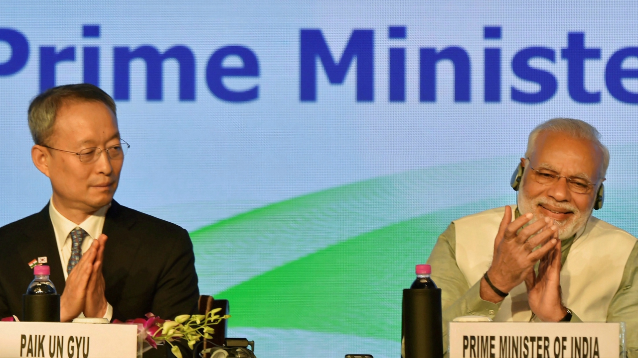 Prime Minister Narendra Modi with Trade, Industry and Energy Minister of Korea Paik Un-Gyu during India-Korea business summit in New Delhi. (PTI)