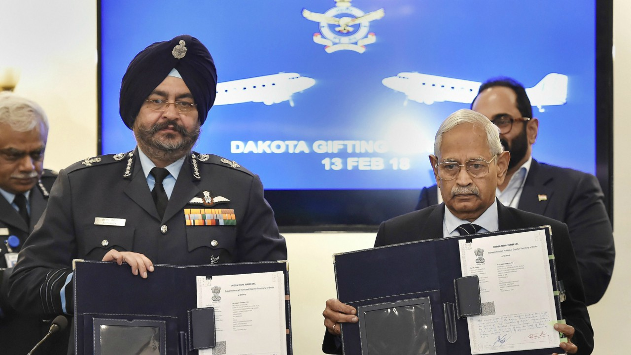 Air Chief Marshal B S Dhanoa with Air Commodore (retd) M K Chandrasekhar during a function to mark ceremonial gifting of the Douglas DC3 Dakota to IAF, in New Delhi. (PTI)