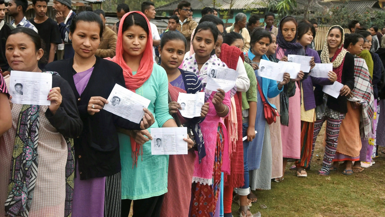 Women stand in a queue to cast their vote at a polling station during the State Assembly elections, in Ri-Bohi district of Meghalaya. (PTI)
