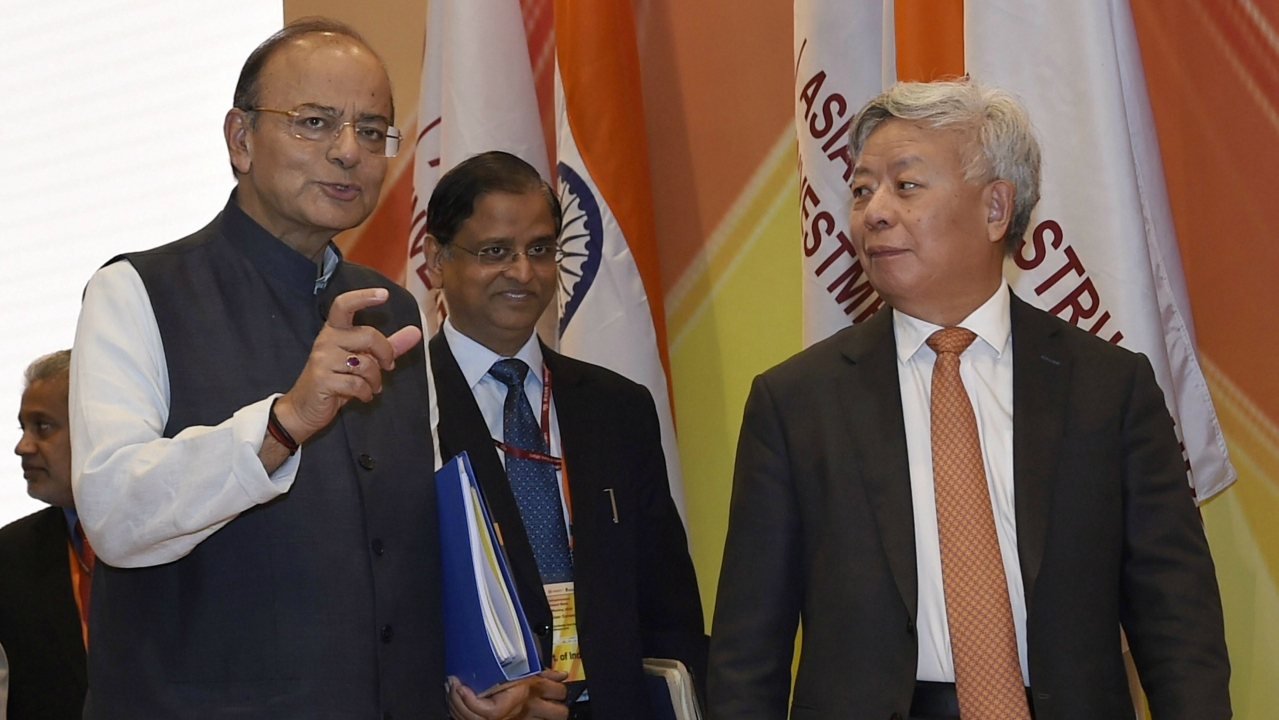 Union Finance Minister Arun Jaitley and AIIB President Jin Liqun speak as they leave after the Curtain Raiser Ceremony of the Asian Infrastructure Investment Bank's Annual Meeting in New Delhi. (PTI)