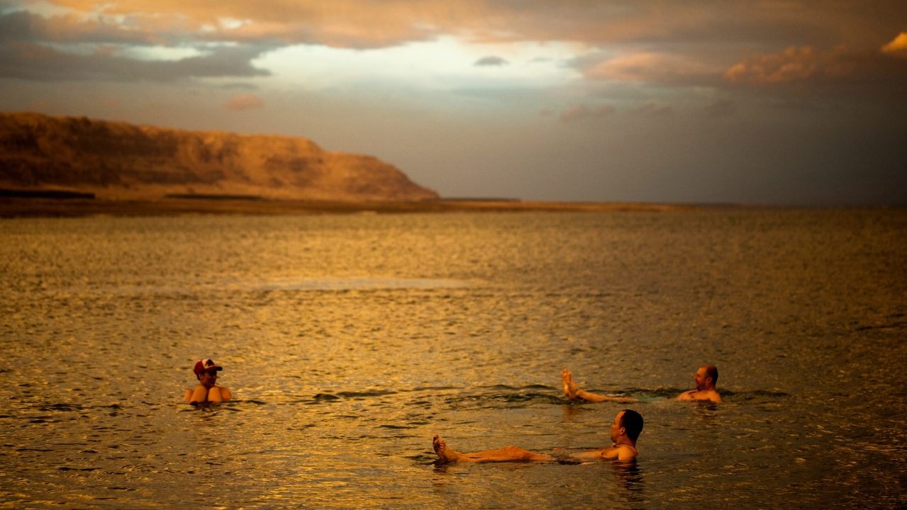 Tourists from Poland float in the Dead Sea during sunset, near Metzoke Dragot in the Israeli occupied West Bank. (REUTERS)