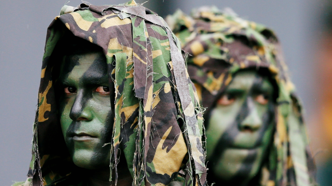 Sri Lanka's Special Task Force (STF) members look on at a rescue demonstration during the 35th anniversary in Kalutara, Sri Lanka. (REUTERS)