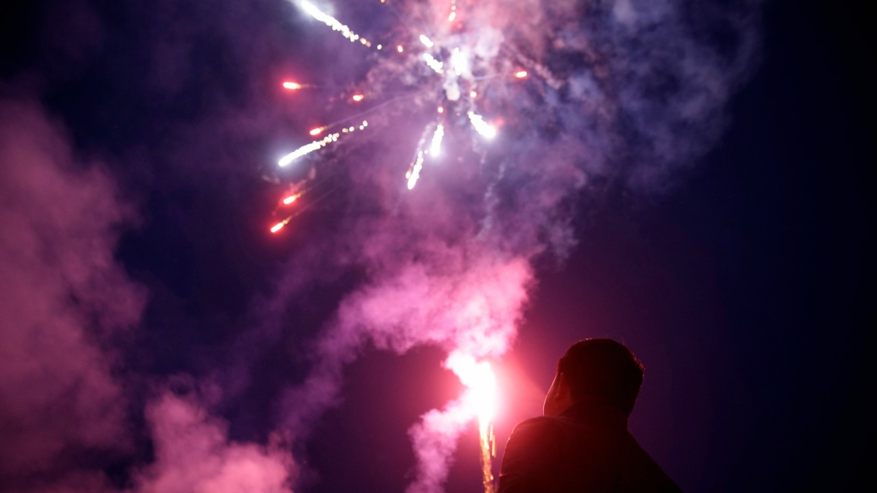 A worker watches fireworks at Liuyang Standard Fireworks Manufactory in Liuyang, Hunan province, China. (REUTERS)