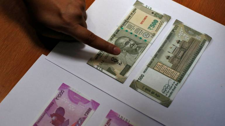 India's Currency Hits Record Low Vs. Dollar On Rising Oil Prices