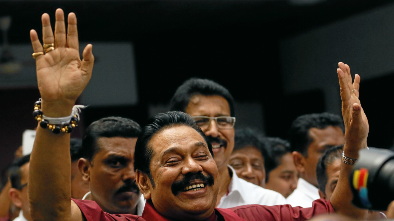 Sri Lanka's former President Mahinda Rajapaksa waves at his supporters at the party office after a news conference after winning the local government election in Colombo, Sri Lanka. (REUTERS)