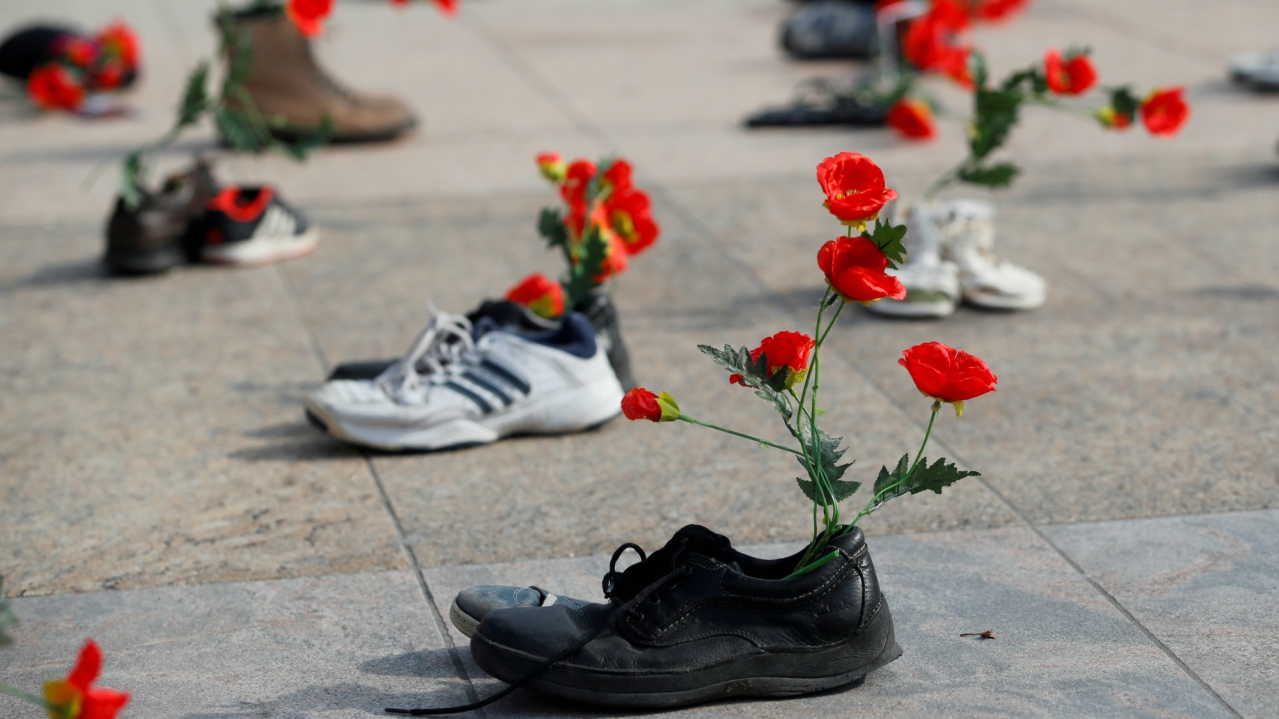 Shoes with flowers are pictured during a demonstration against the speech of Seyyed Ali Reza Avai, Minister of Justice of Iran, at the Human Rights Council, in front of the United Nations in Geneva, Switzerland. (REUTERS)