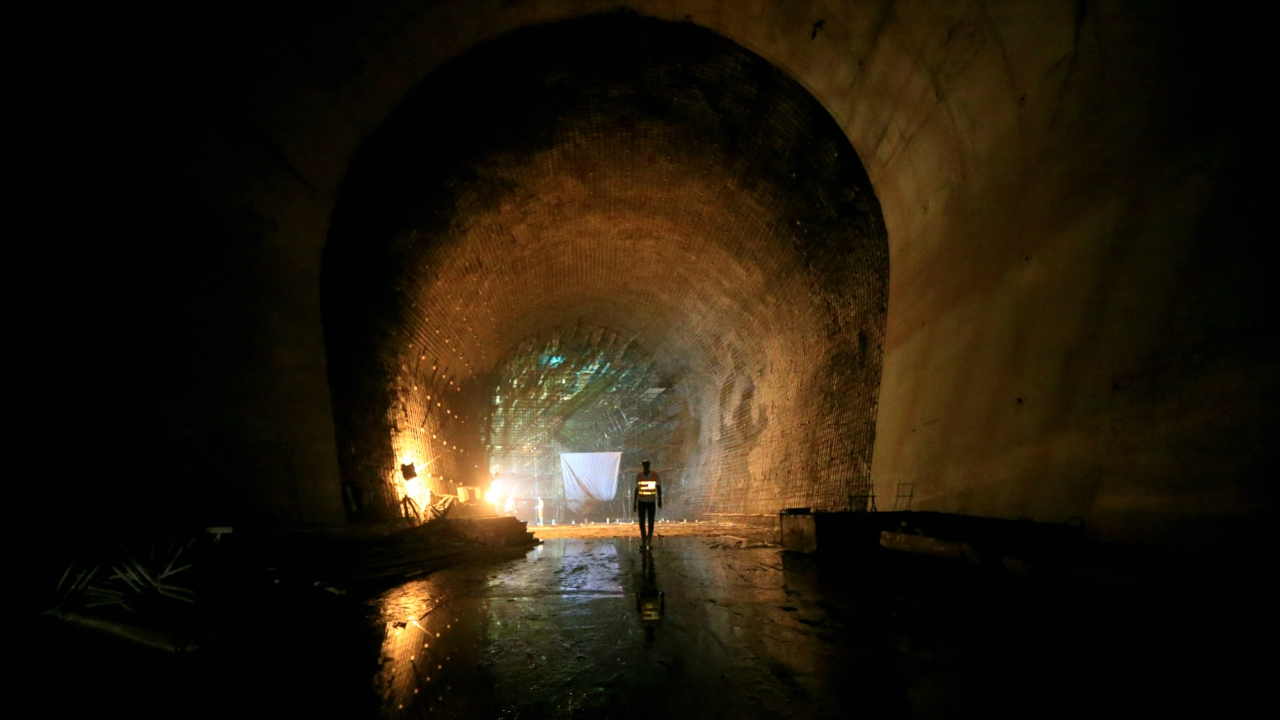A contractor walks in a tunnel at the construction site at Karuma 600 megawatts hydroelectric power project under construction on River Nile, Uganda.  (REUTERS)