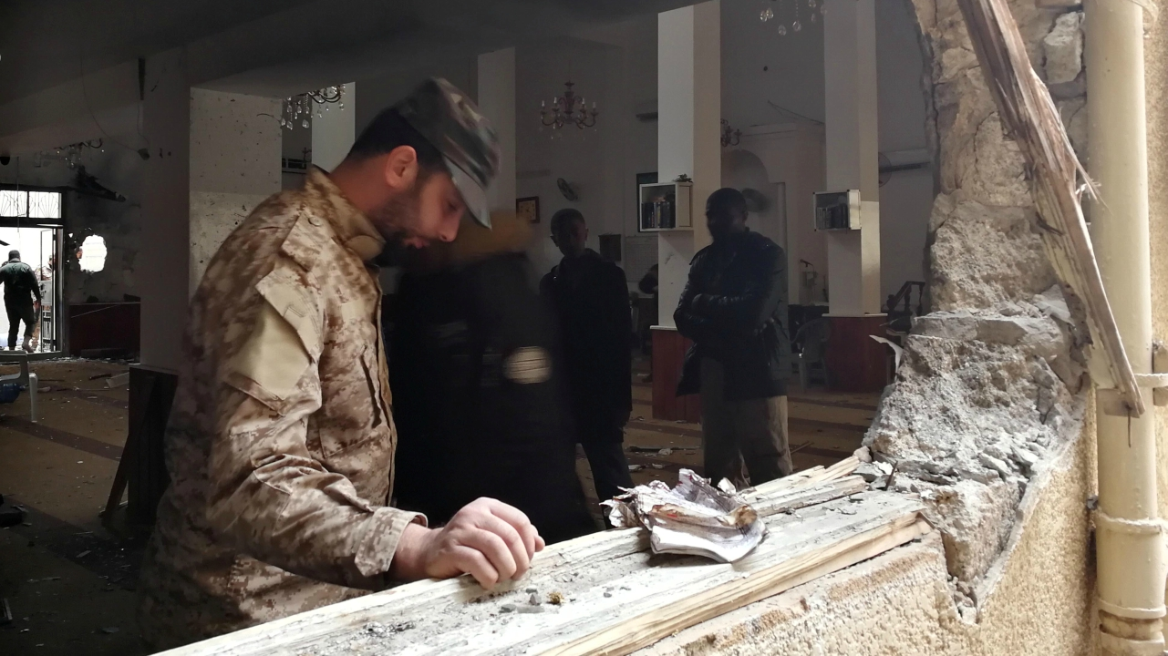 A member of the Libyan National Army inspects the damage following a twin bombing inside a mosque in Benghazi, Libya February 9, 2018. (Reuters)