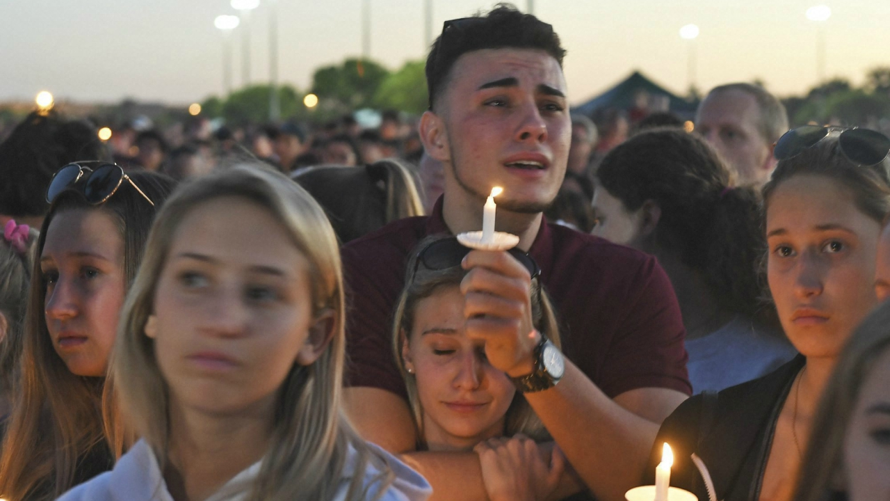Mourners gather at a vigil that was held for the victims of the shooting at Marjory Stoneman Douglas High School, Thusday, Feb. 15, 2018, in Parkland, Fla. The teenager accused of using a semi-automatic rifle to kill more than a dozen people and injuring others at a Florida high school confessed to carrying out one of the nation's deadliest school shootings and concealing extra ammunition in his backpack, according to a sheriff's department report released Thursday. (AP/PTI)