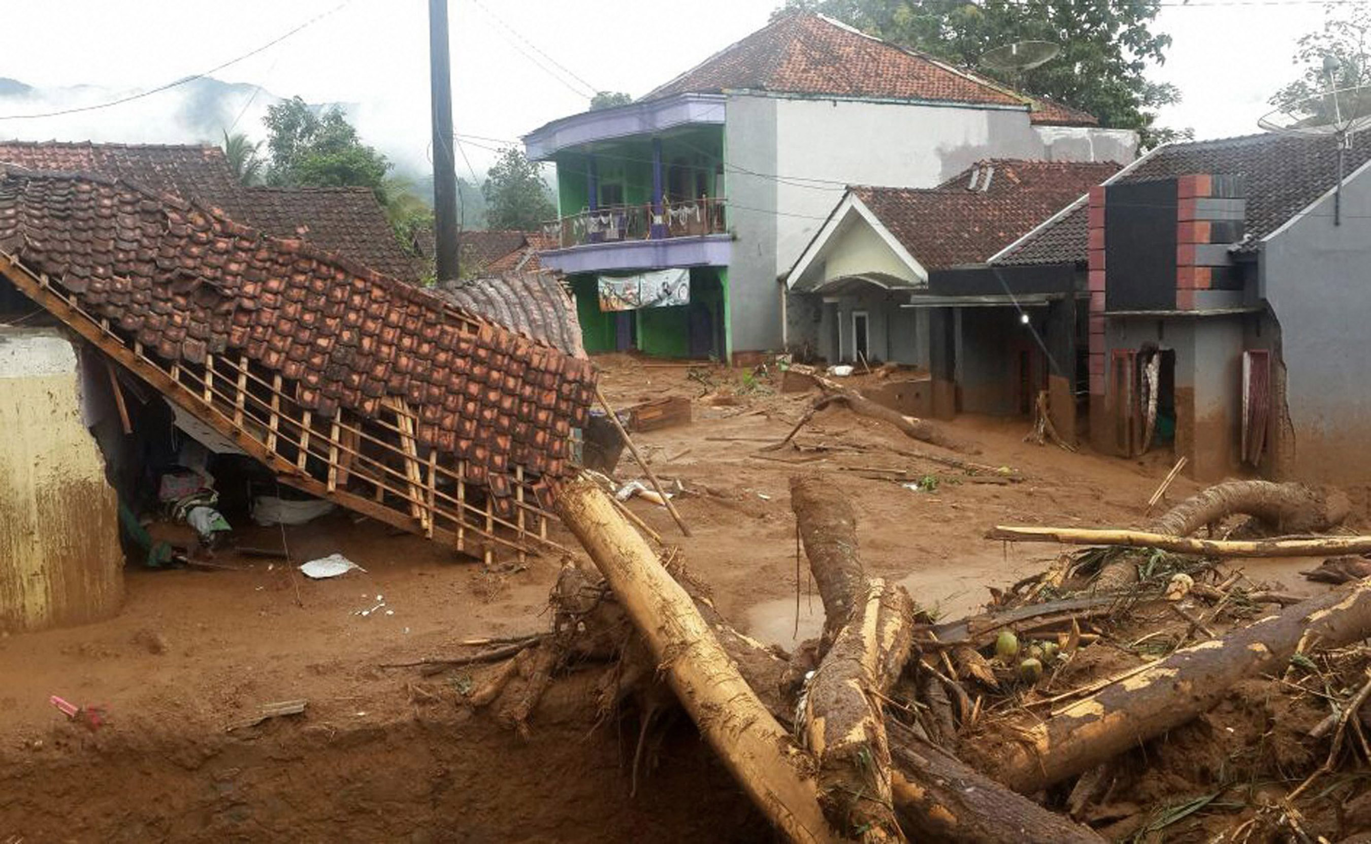 Houses are seen affected by a landslide in Brebes, Central Java, Indonesia. (AP/PTI)