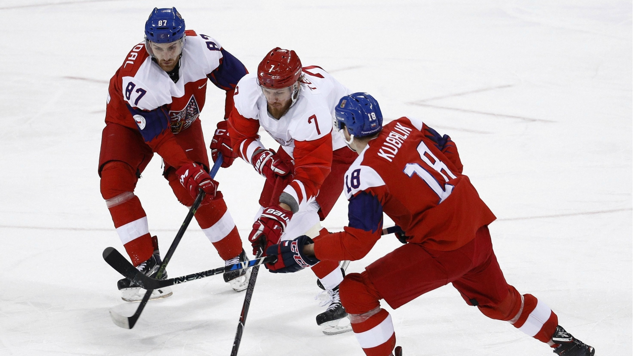 Russian athlete Ivan Telegin (7) skates with the puck against Jakub Nakladal (87) and Dominik Kubalik (18), of the Czech Republic, during the first period of the semifinal round of the men's hockey game at the 2018 Winter Olympics in Gangneung, South Korea. (AP/PTI)