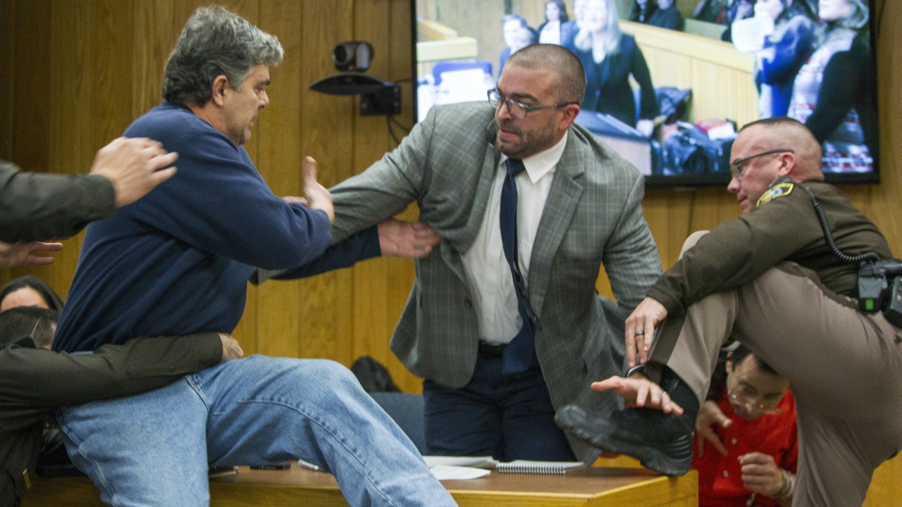 Randall Margraves, father of three victims of Larry Nassar , left, lunges at Nassar, bottom right, Friday, Feb. 2, 2018, in Eaton County Circuit Court in Charlotte, Mich. The incident came during the third and final sentencing hearing for Nassar on sexual abuse charges. The charges in this case focus on his work with Twistars, an elite Michigan gymnastics club. (AP/PTI)