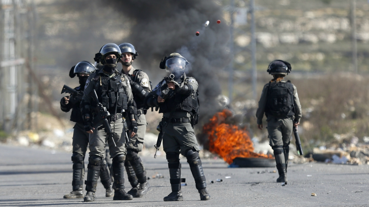 Israeli border policemen fires tear gas at Palestinians during clashes following a protests against US. President Donald Trump's decision to recognize Jerusalem as the capital of Israel, in the West Bank city of Ramallah, Friday, Feb 2, 2018. (AP/PTI)