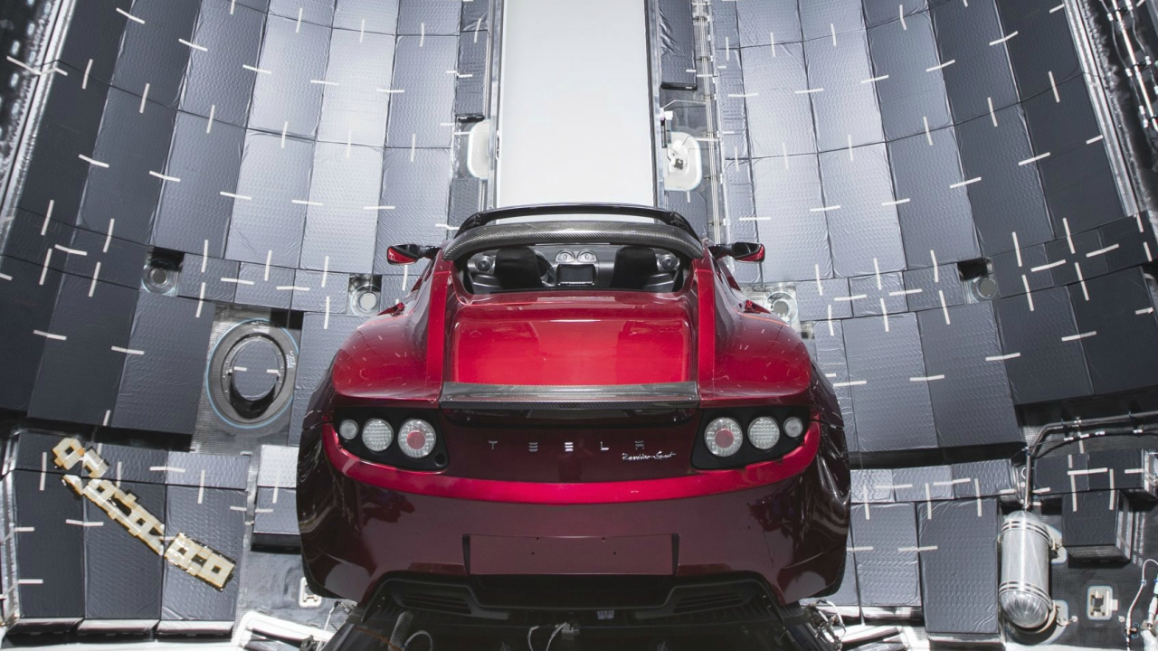 This Dec. 6, 2017 photo made available by SpaceX shows a Tesla car next to the fairing of a Falcon Heavy rocket in Cape Canaveral, Fla. For the Heavy's inaugural flight, the rocket will carry up Elon Musk's roadster. In addition to SpaceX, Musk runs the electric car maker Tesla. (AP/PTI)