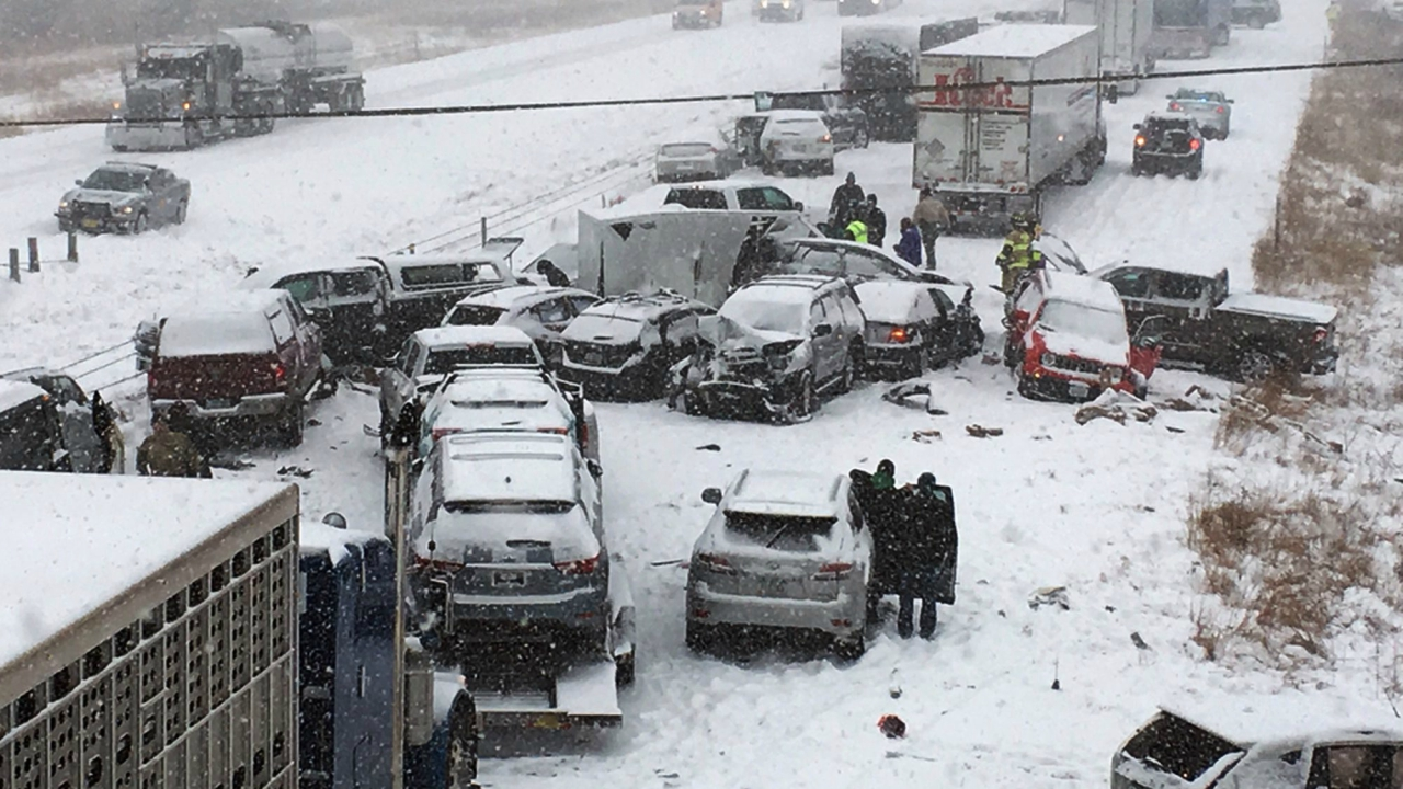 In this photo provided by KCCI-TV, emergency personnel tend to vehicles on Interstate 35 in Ames, Iowa, after dozens of vehicles collided on the snow-covered freeway on Monday, forcing the closure of the southbound lanes. (AP/PTI)
