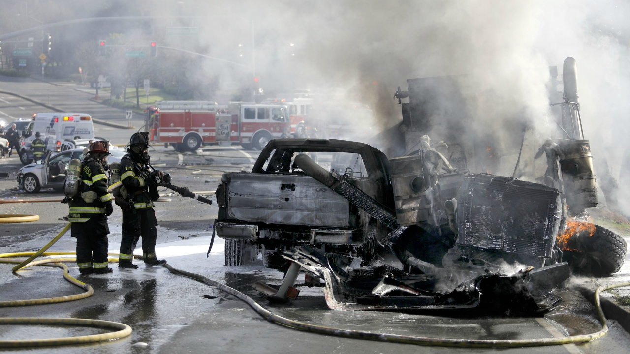 Firefighters work to put out a multi-vehicle fire at Fountaingrove Parkway and Mendocino Avenue in Santa Rosa. (AP/PTI)