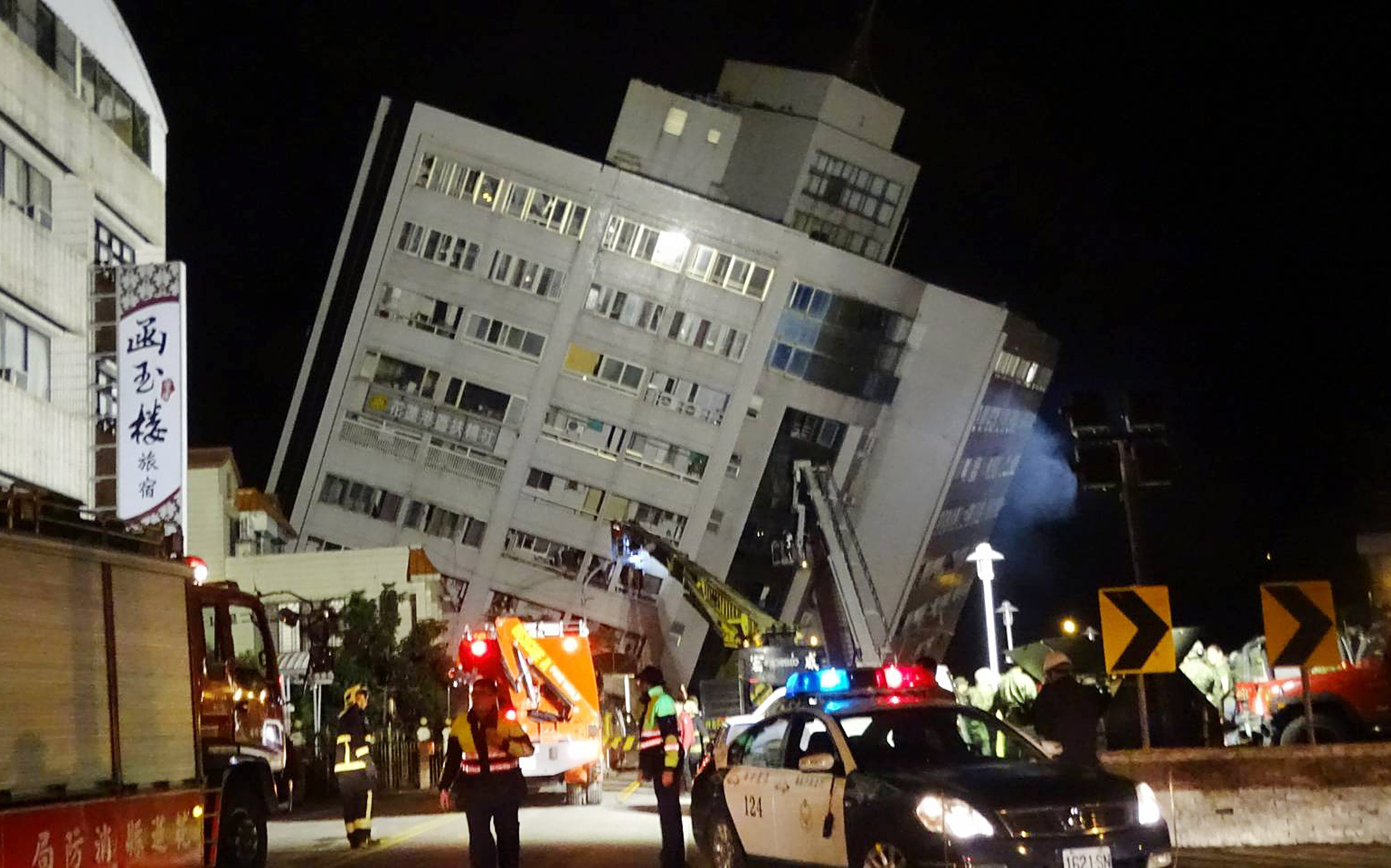 Rescuers are seen entering a building that collapsed onto its side from an early morning 6.4 magnitude earthquake in Hualien County, eastern Taiwan (AP/PTI)