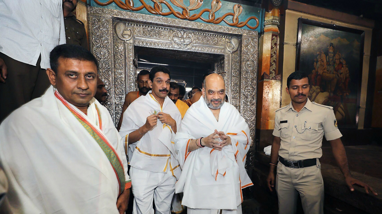 BJP President Amit Shah visits Kukke Shree Subrahmanya temple in Sullia on Tuesday. Shah is in Karnataka as part of the party's election campaign for the upcoming assembly election in the state.(PTI)