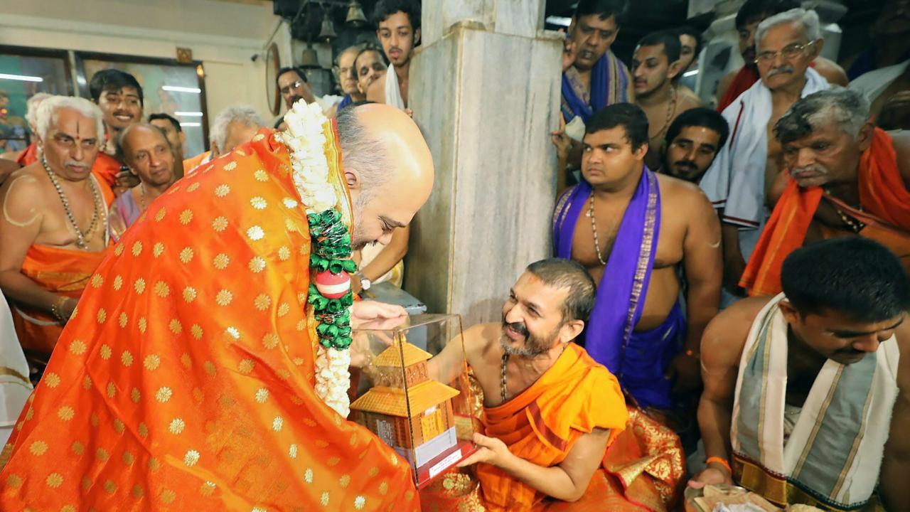 BJP National President, Amit Shah visits the Udupi Sri Krishna Matha in Udupi Karnataka on Wednesday. (PTI)