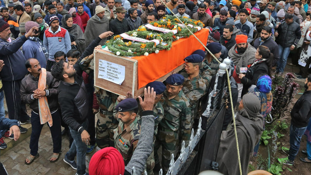 Army officers and jawans carry body of Indian Army JCO Madan Lal Choudhary, who was killed in a terrorist attack at Sunjuwan Army camp, for his final rites in Hiranagar, 60 kms from Jammu on Monday. (PTI)