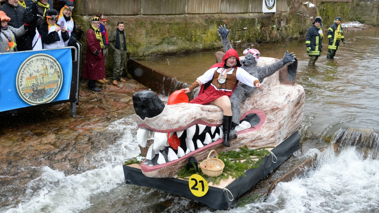 Carnival revellers ride down the Schiltach stream atop their float during the 'Bach na fahre' (race down the stream) raft contest on Rose Monday in the south-western Black Forest town of Schramberg, Germany. (Reuters)