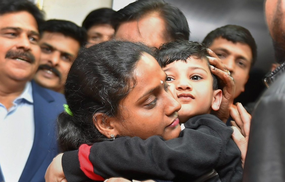 The five-year-old child, who was abducted from his school bus a day before Republic Day from Dilshad Gaden area in Delhi, unites with his mother after being rescued by Delhi Police from the alleged kidnappers, at a press conference in New Delhi on Tuesday. (PTI)