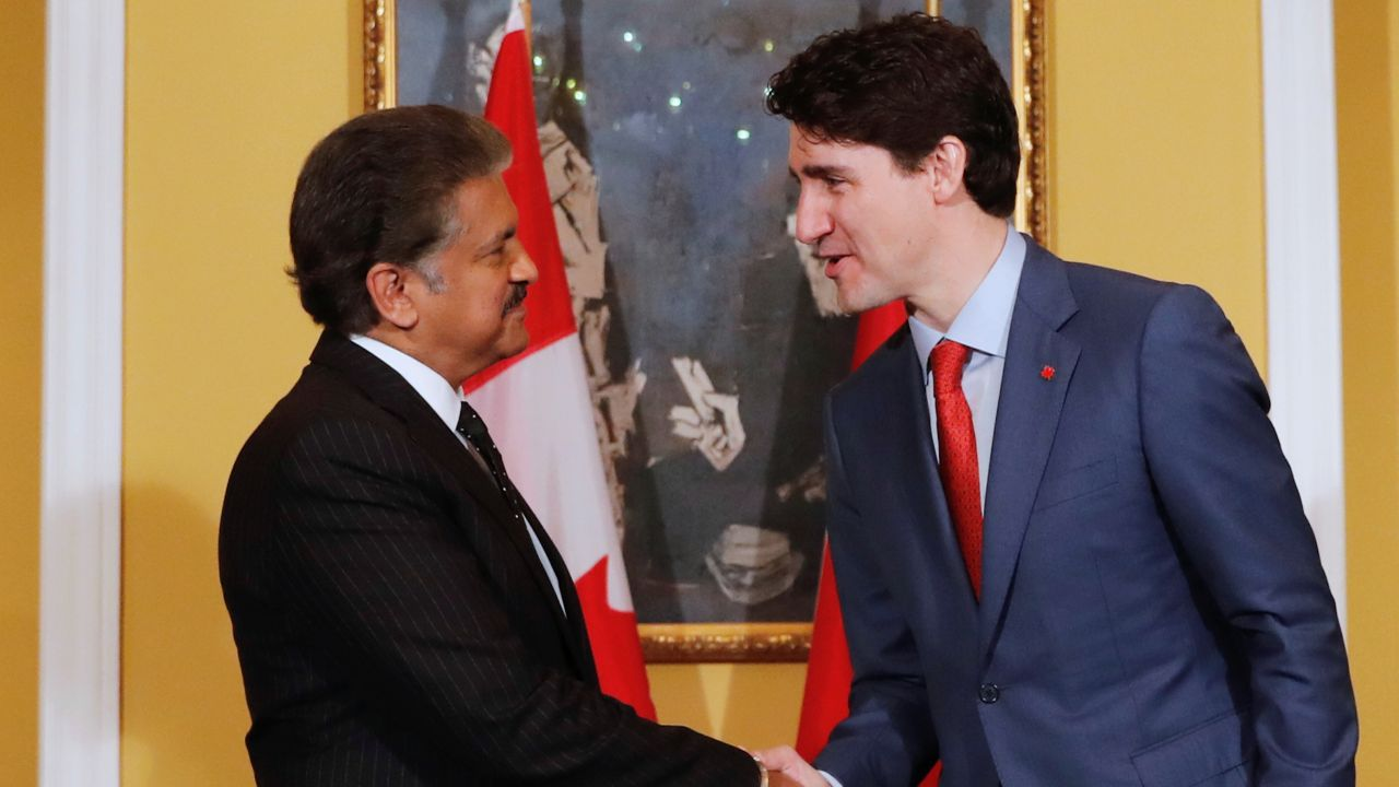 Canadian PM shakes hand with Anand Mahindra, Chairman of Mahindra Group during a meeting in Mumbai on Tuesday. (Reuters)