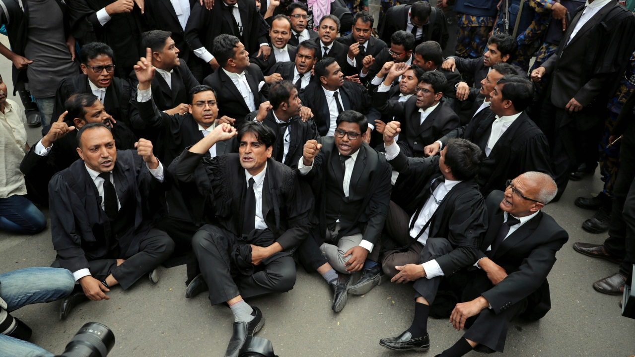 Lawyers supporting Bangladesh Nationalist Party (BNP) shout slogans as they sit on a street during a protest in Dhaka, Bangladesh February 8, 2018. (Reuters)