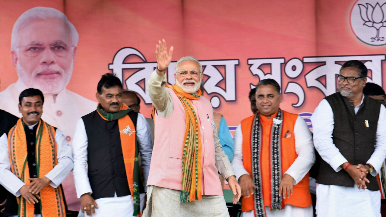 Prime Minister Narendra Modi waves at the public during an election campaign rally ahead of Tripura Assembly Election in Sonamura on Thursday. (PTI)