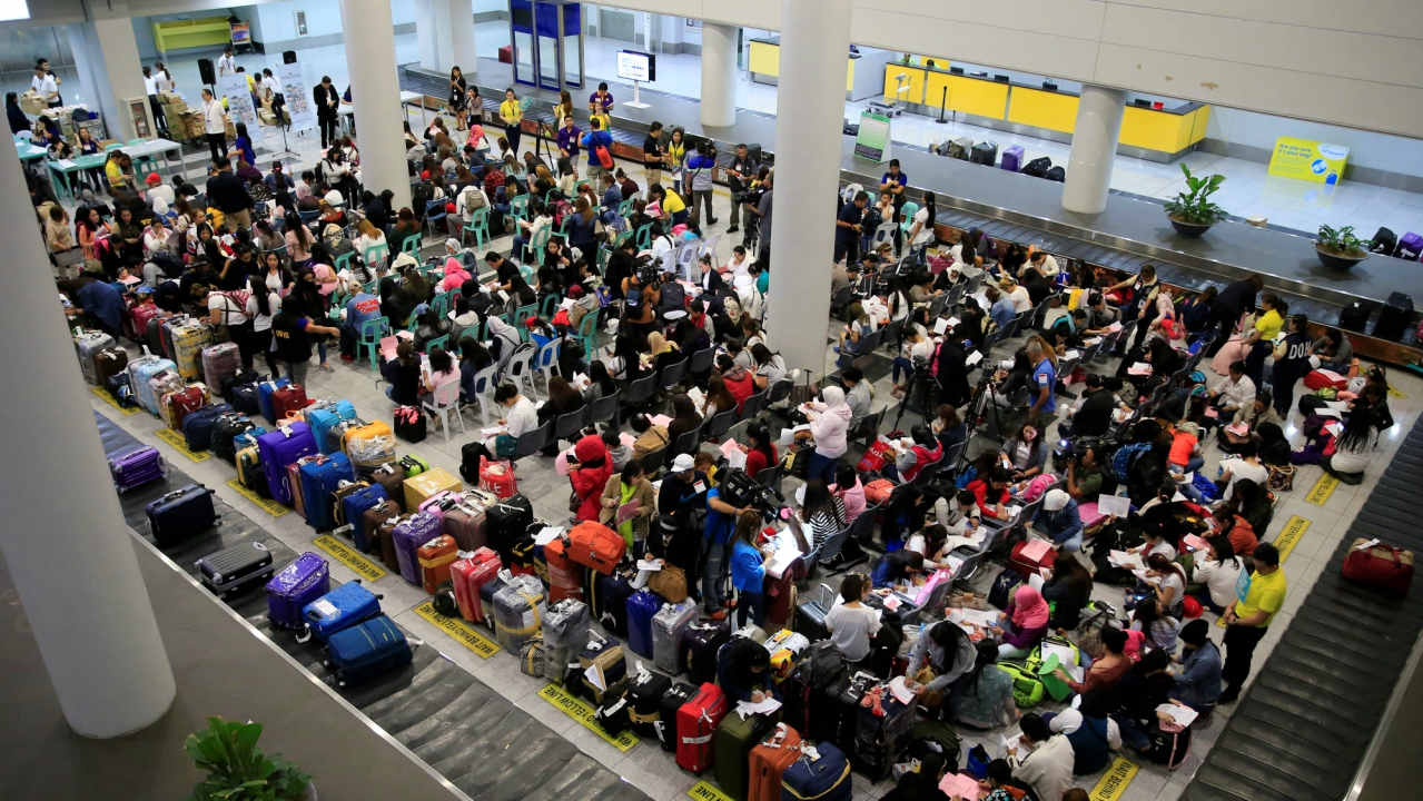 Overseas Filipino Workers (OFW) from Kuwait gather upon arrival at the Ninoy Aquino International Airport in Pasay city, Metro Manila, Philippines February 21, 2018. Following President Rodrigo Duterte's call to evacuate workers after a Filipina was found dead stuffed inside a freezer. (Reuters)