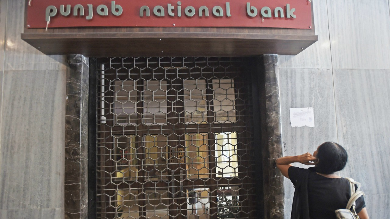 A woman looks on as CBI team seals Punjab National Bank's South Mumbai branch at Brady House in Mumbai on Monday. The PNB fraud case involving jeweller Nirav Modi was allegedly carried out of this branch. (PTI)