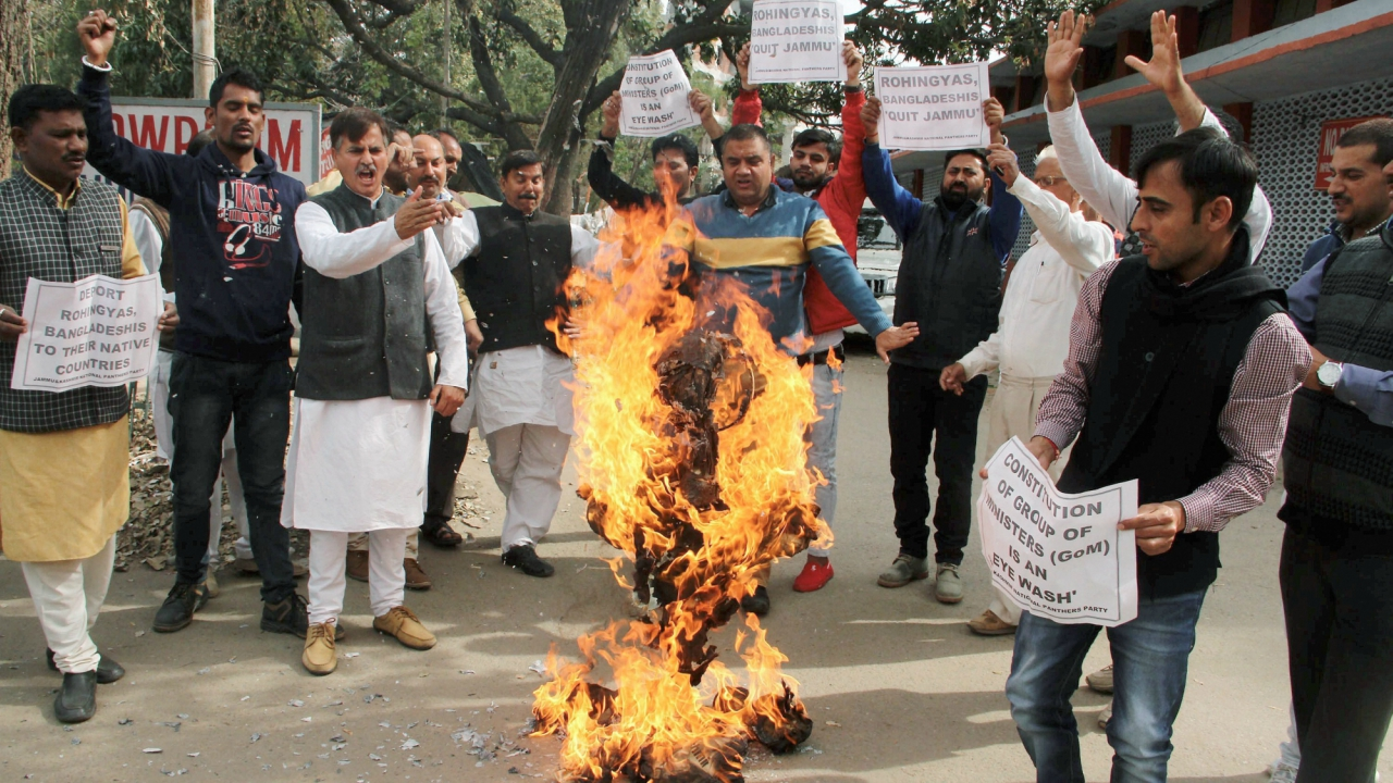 Activists of Jammu and Kashmir National Panthers Party (JKNPP) burn an effigy of BJP and State government during a protest against the settlement of Rohingyas and Bangladeshis in Jammu, on Thursday. (PTI)