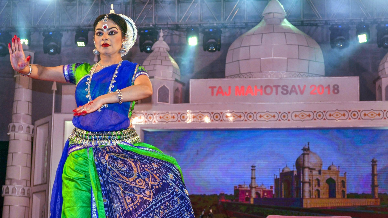 Canadian artist Enakshi Sinha performs an Odissi dance during Taj Mahotsav 2018, in Agra on late Thursday. (PTI)