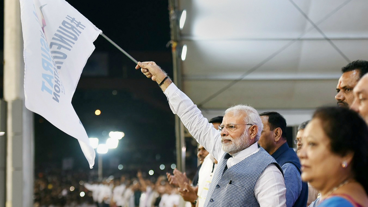 Prime Minister Narendra Modi flagging off the Surat Marathon, in Gujarat on Sunday. (PTI)