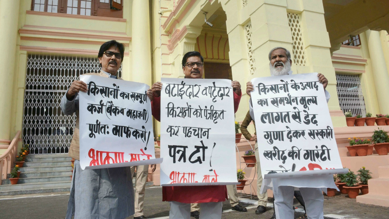 CPI (ML) legislators stage a demonstration on the first day of the budget session of State Assembly in Patna on Monday. (PTI)