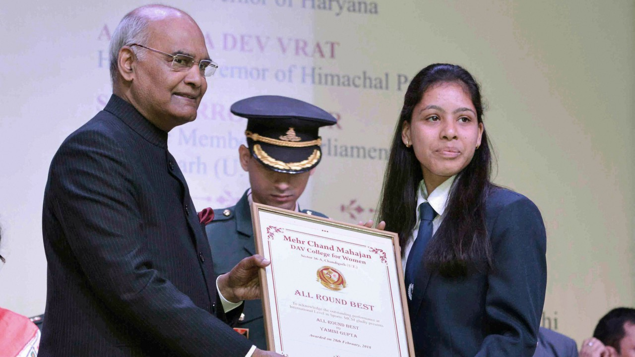 President Ram Nath Kovind presents an award to a student during the Golden Jubilee celebration of Mehr Chand Mahajan DAV College For Women in Chandigarh. (PTI)