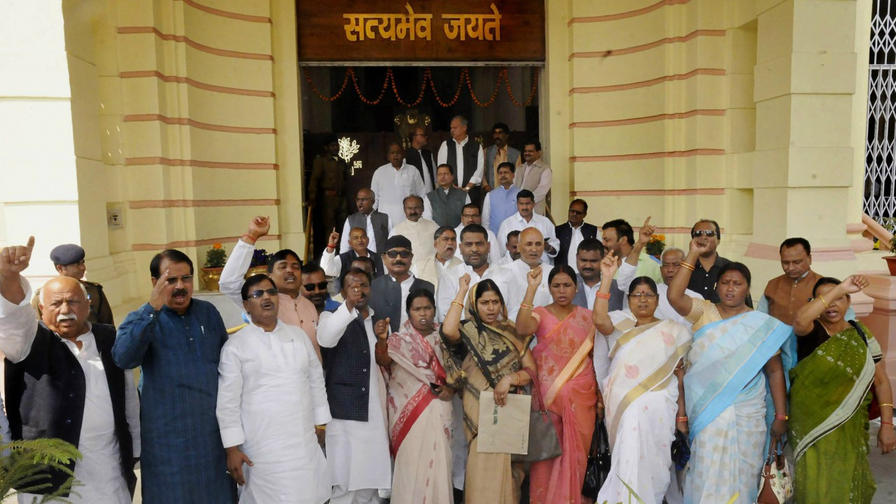Rashtriya Janta Dal MLAs hold a demonstration outside the Bihar Assembly during its ongoing budget session in Patna. (PTI)