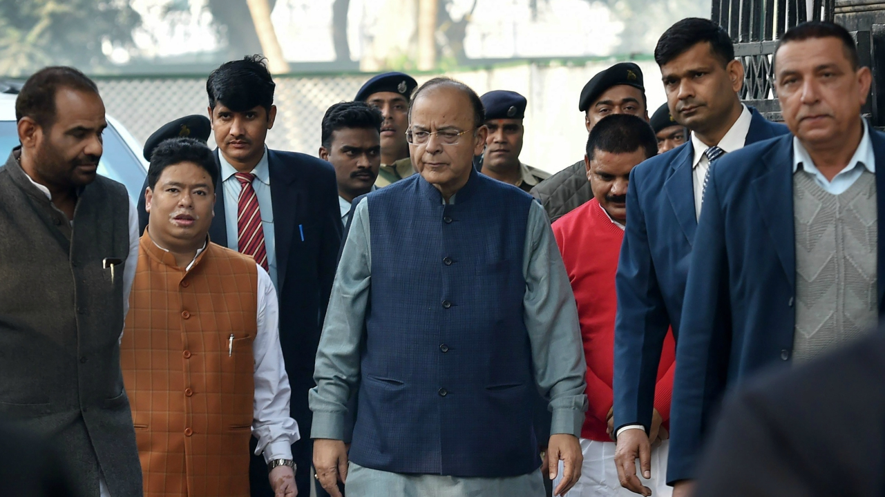 Finance Minister Arun Jaitley arrives to meet residents of Delhi Villages gathered to felicitate him for 'Kisan' Budget, in New Delhi on Friday. BJP MP Ramesh Bidhuri is also seen. (PTI)