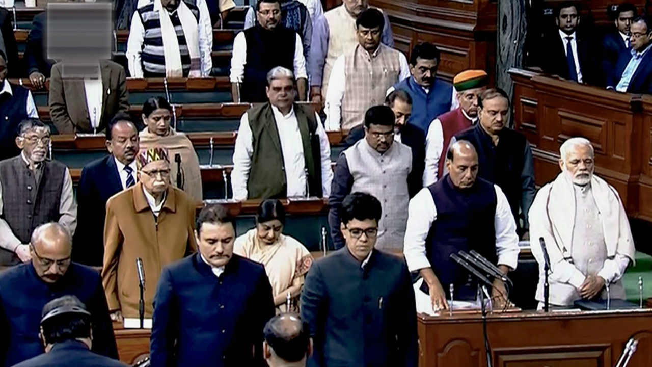 Prime Minister Narendra Modi, along with other ministers and members, pays tribute to veteran BJP member Hukum Singh in the Lok Sabha in New Delhi on Monday. Singh, an MP from Uttar Pradesh's Kairana, died of breathing problems in Noida's JP Hospital on Saturday. (PTI)