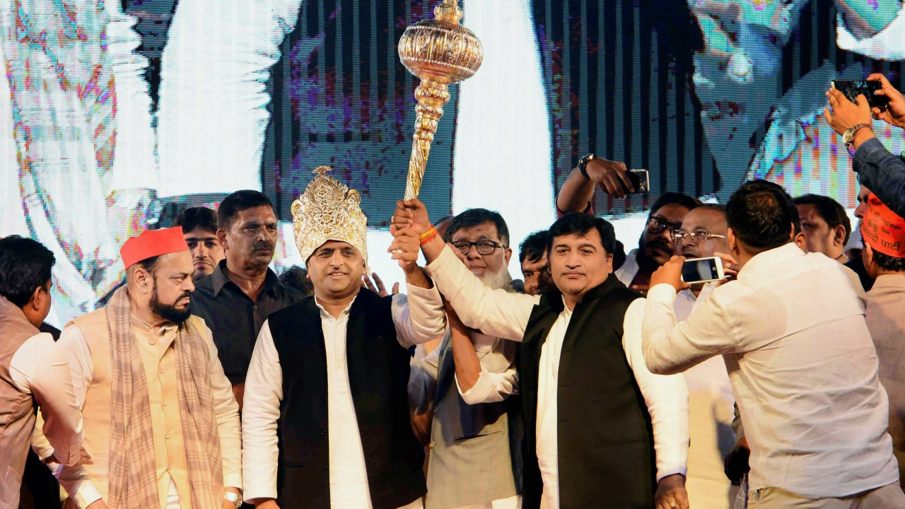 "Samajwadi Party leader Akhilesh Yadav being presented a mace during the party's ""Desh Bachao Desh Banao"" rally in Mumbai on Sunday night. (PTI)"