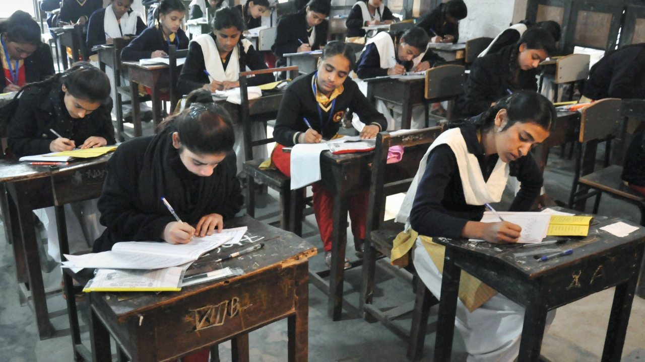 Students appear in the 12th class examination of Uttar Pradesh Board at an examination centre in Moradabad. (PTI)