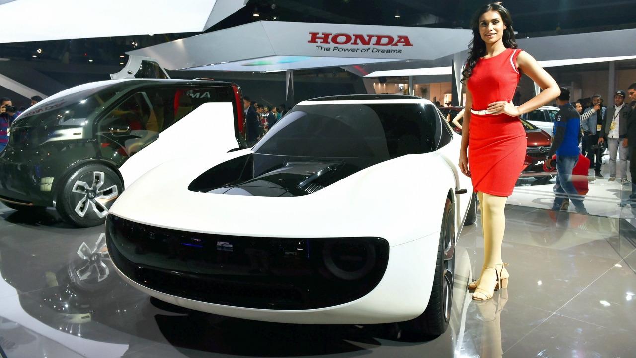 A model poses next to a concept car at auto major Honda's stall at the Auto Expo 2018 in Greater Noida on Wednesday. (PTI)
