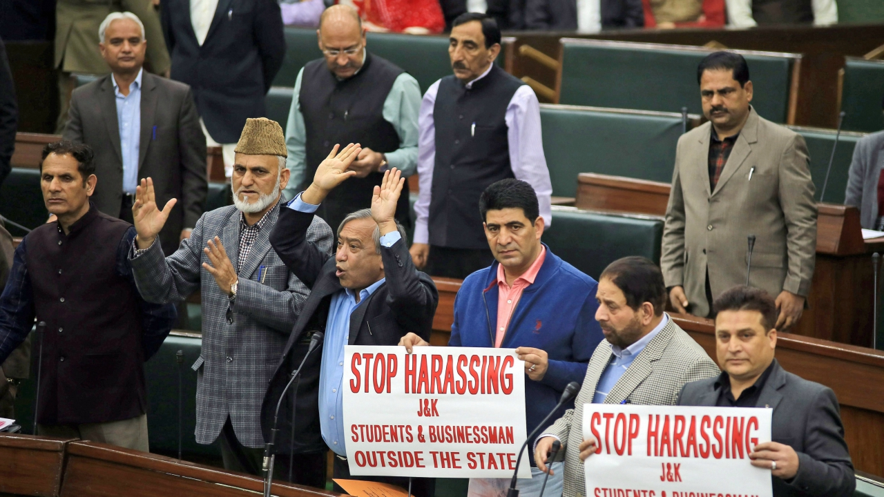 Opposition MLAs protest over the alleged harassment of J&K students and businessmen outside the state, in the legislative Assembly in Jammu on Thursday. (PTI)