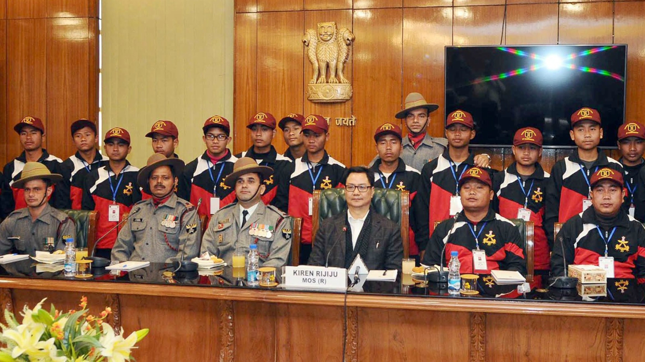 Minister of State for Home Affairs Kiren Rijiju with a group of students from Churachandpur, Manipur attends the National Integration Tour, organised by the Assam Rifles, in New Delhi on Friday. (PTI)